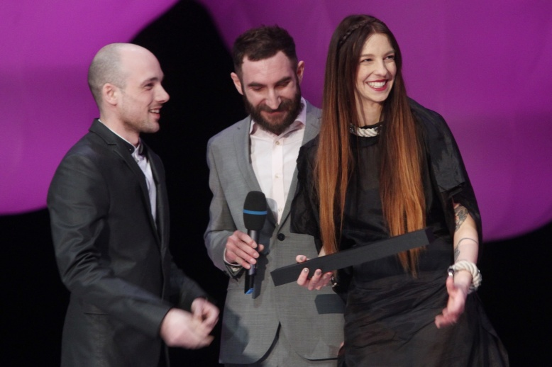 Last year's winners -jewelry designers from Zorya- hand out first award to Bet Orten, Photographer of the Year