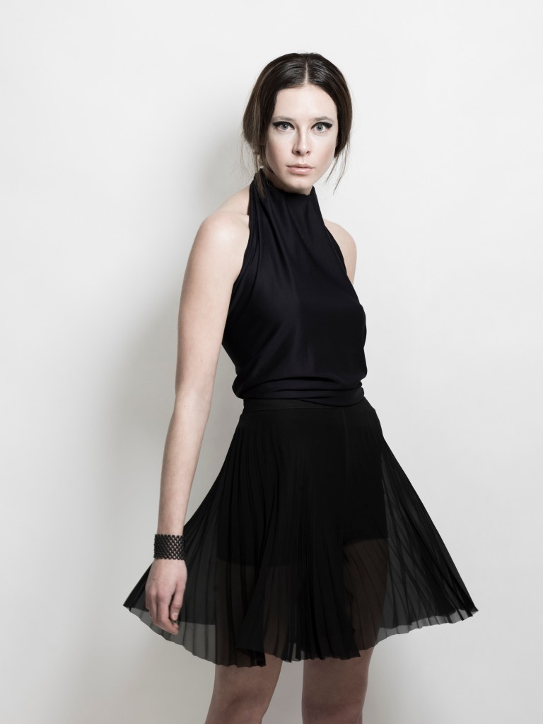 A halter, black accordian pleated dress is exactly what every woman needs in her wardrobe. This one by LaFormela is perfect